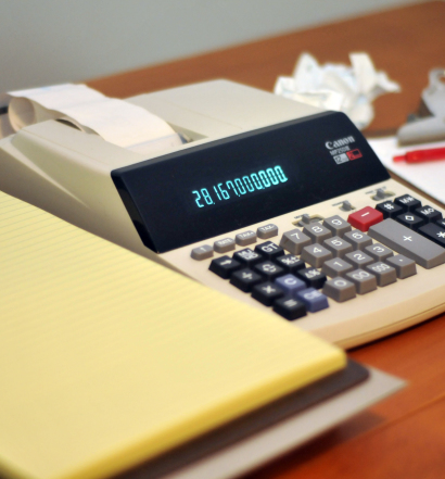 A notepad, adding machine, and clipboard