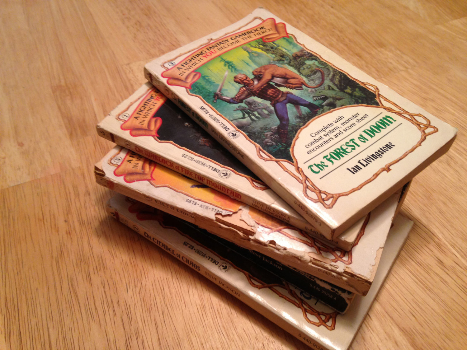 A stack of worn FIghting Fantasy books
